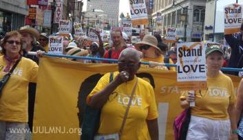 "hundreds march in Newark carrying ""Stand on the Side of Love: Black Lives Matter"" signs"