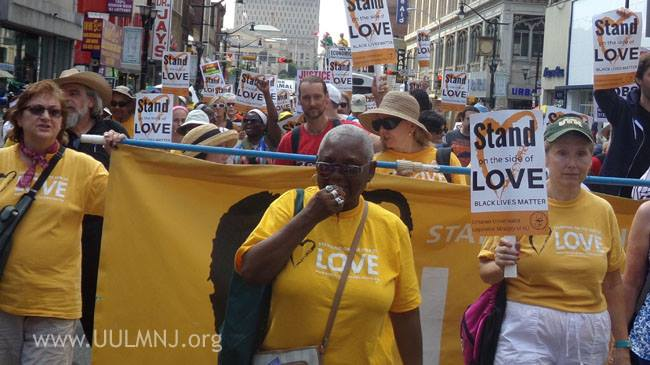 """hundreds march in Newark carrying """"Stand on the Side of Love: Black Lives Matter"""" signs"""